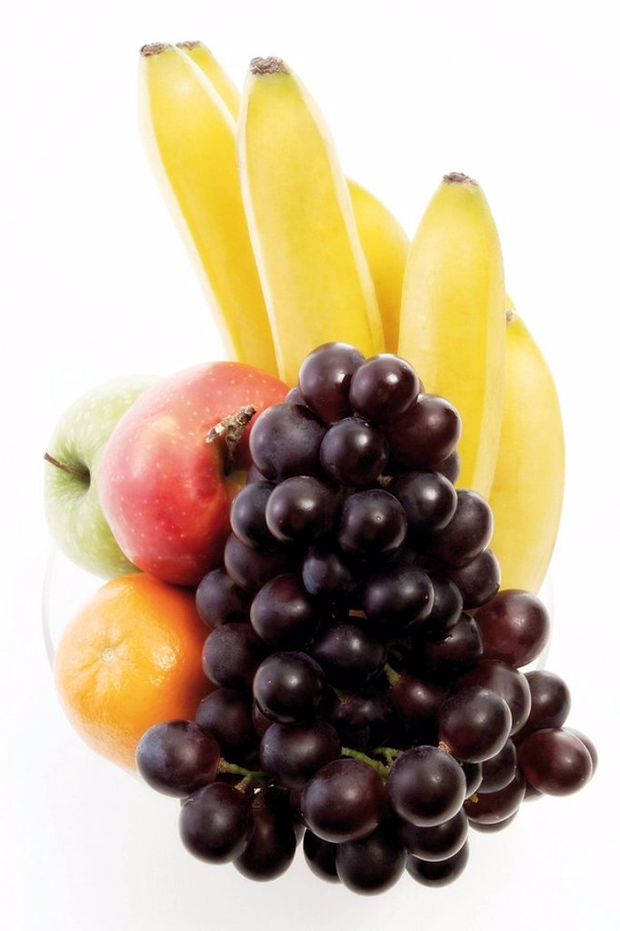 Stock Photo: 1848R-399375 Vitamins, bowl of fruit: apples, orange, bananas and red grapes