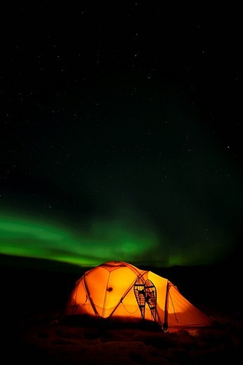 Stock Photo: 1848R-502912 Illuminated expedition tent and traditional wooden snow shoes, Northern Lights, Polar Lights, Aurora Borealis, green, near Whitehorse, Yukon Territory, Canada