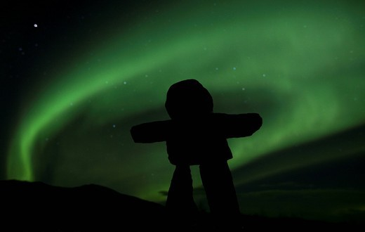 Stock Photo: 1848R-502930 Silhouette of Inuit stone man, inukshuk, inuksuk, stone landmark or cairn, Northern Lights, Polar Lights, Aurora Borealis, green, near Whitehorse, Yukon Territory, Canada