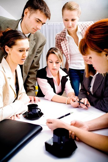 Young business team at a meeting in the office : Stock Photo