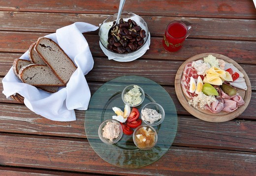 Stock Photo: 1848R-503874 Hearty snack, bread and a plate with a variety of spreads, Brettljause, a plate with cold cuts, Styrian scarlet runner beans and a glass of Schilcher Sturm, must wine, Buschenschank, local tavern, Styria, Austria, Europe