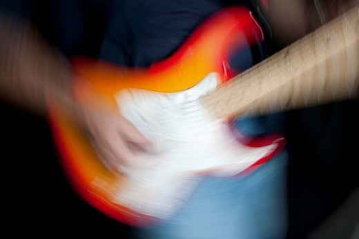 Stock Photo: 1848R-505161 Man playing an electric guitar, blurred
