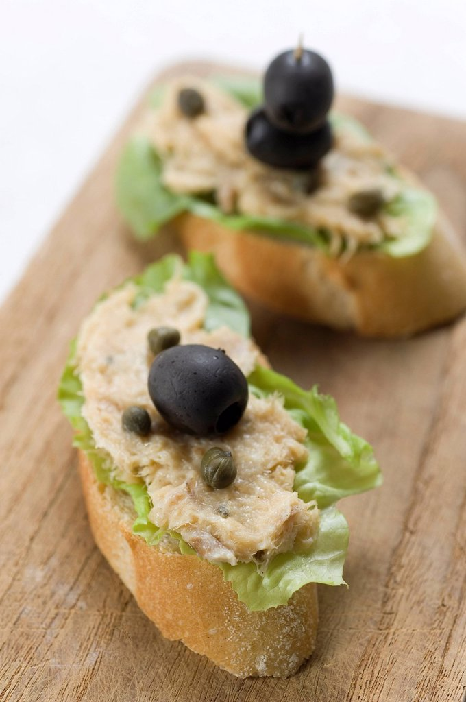 Rillettes de Maquereau, spread made of mackerel on a French baguette with olives and capers : Stock Photo