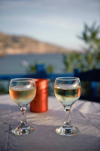 Wine glasses and a wine carafe in a tavern, Lefkos, island of Karpathos, Aegean Islands, Dodecanese, Aegean Sea, Greece, Europe : Stock Photo