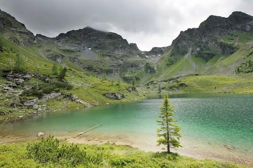 Moaralmsee lake and in the rear Mt. Filzscharte, Schladminger Tauern mountain range, Styria, Austria, Europe : Stock Photo
