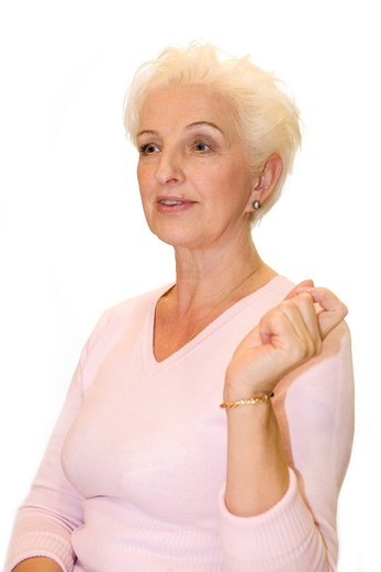 A woman raises her hand affectedly : Stock Photo