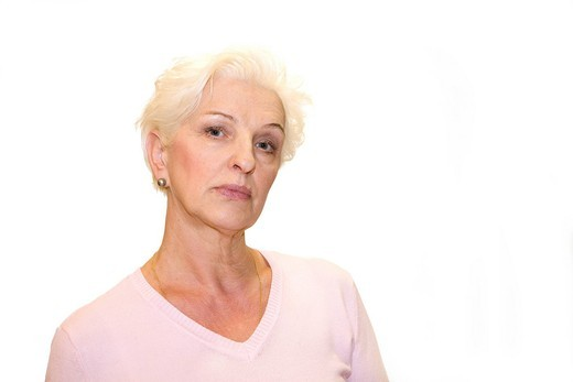 Stock Photo: 1848R-509772 A light blond woman looking arrogantly, direct look