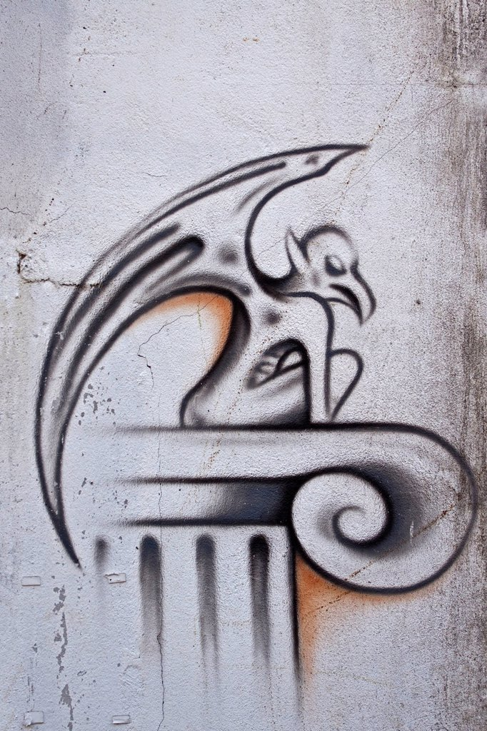 Mythical creature, winged demon from hell, graffiti on a wall : Stock Photo
