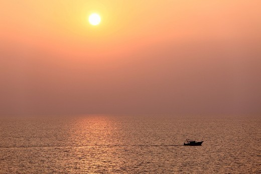 Stock Photo: 1848R-511346 Boat on the sea, sunset, Kovalam, Kerala, southern India, India, Asia