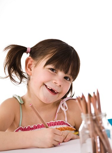 Little girl with pigtails : Stock Photo