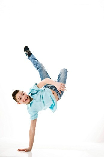 Stock Photo: 1848R-511615 A boy leaping into the air
