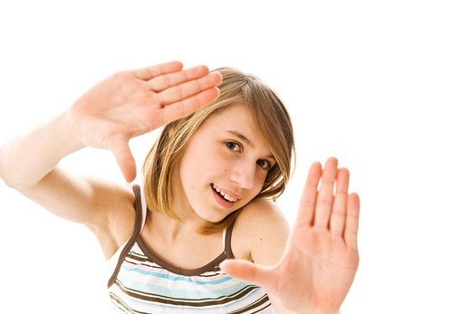A girl framing the viewer with her hands : Stock Photo