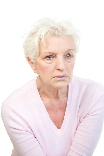 Stock Photo: 1848R-511850 A mature woman staring sideways in horror