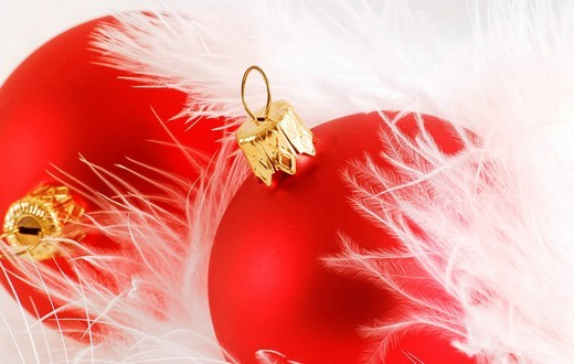 Red Christmas balls decorated with feathers : Stock Photo