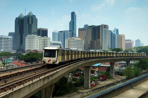 Elevated train and skyline, Kuala Lumpur, Malaysia, Southeast Asia : Stock Photo
