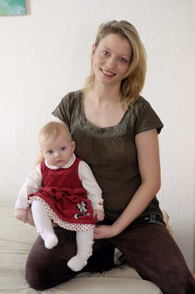 Stock Photo: 1848R-513394 Mother holding baby, girl, 8 months old