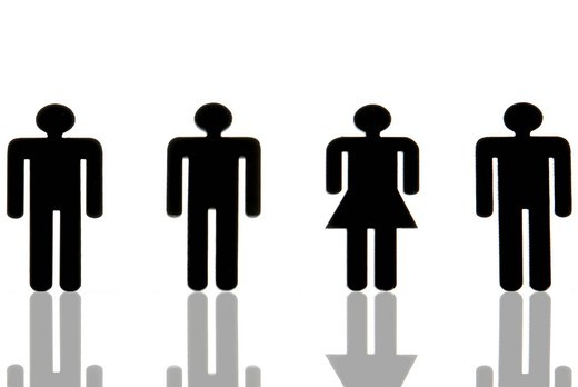 Three male figures and one female figure, symbol for quota for number of women, gender balance : Stock Photo