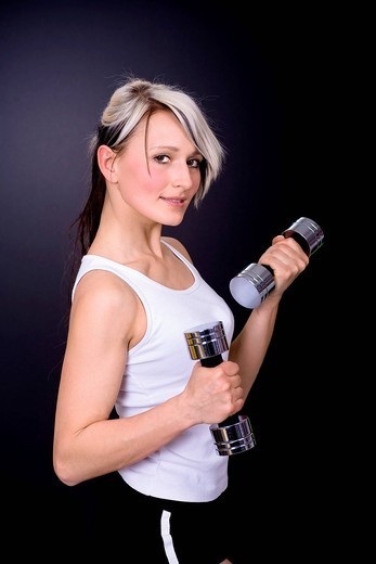 Stock Photo: 1848R-514210 Young woman exercising