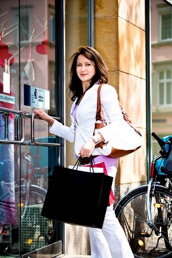 Young woman on a shopping expedition in the city : Stock Photo