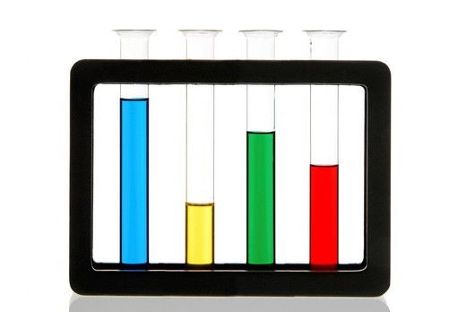 Stock Photo: 1848R-515139 Different colored liquids in test tubes in a stand
