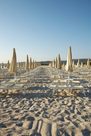 Stock Photo: 1848R-515237 Parasols and deck chairs on a beach in the morning, Sardinia, Italy, Europe