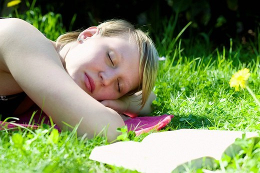 Stock Photo: 1848R-515610 Young woman lying on a meadow, relaxing, Germany, Europe