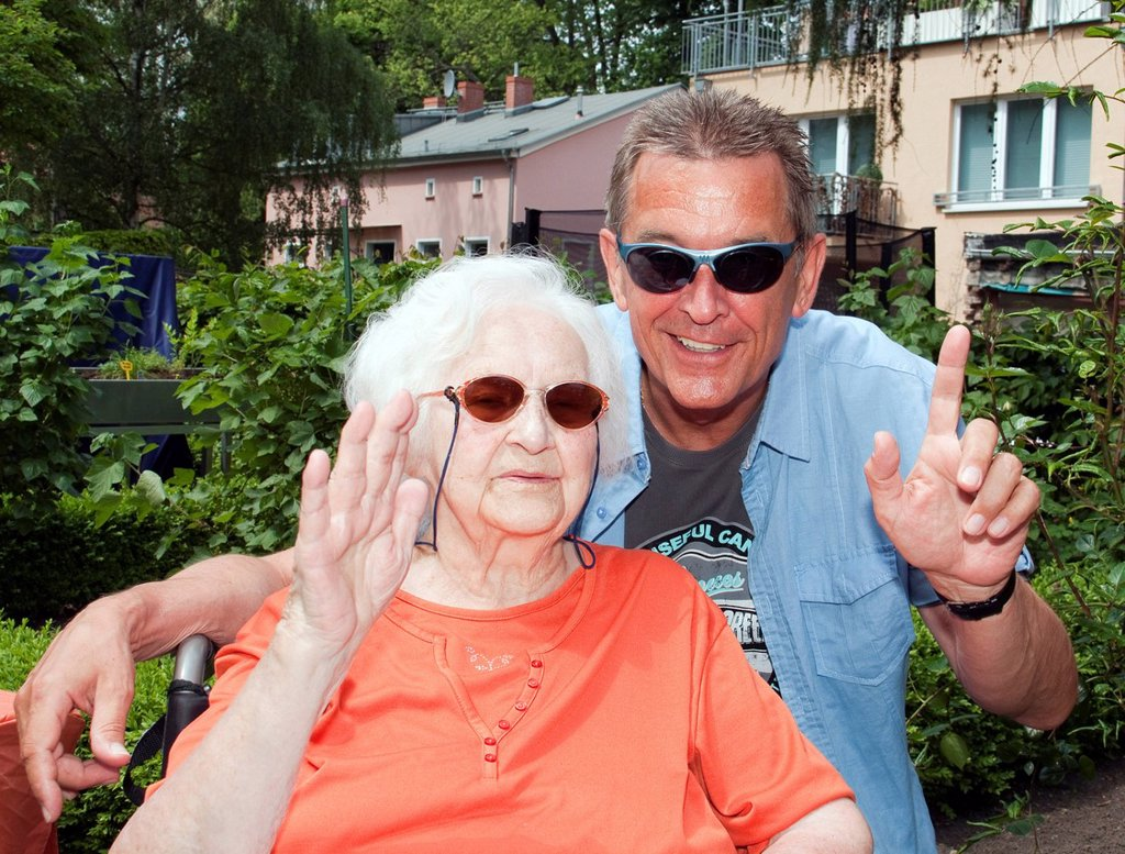 97 year old nursing home resident with her son_in_law : Stock Photo