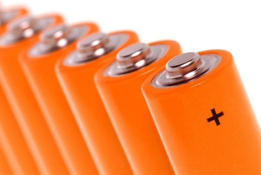 Stock Photo: 1848R-516732 Row of orange batteries
