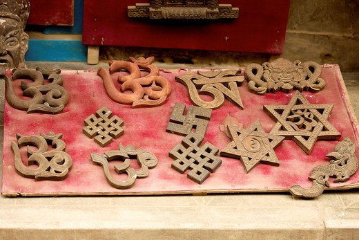 Stock Photo: 1848R-517830 Hindu and Buddhist symbols, including the swastika, the Star of David and the Aum symbol, Om symbol, in a shop window, Patan, Nepal, Asia