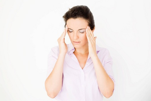 Woman suffering from headaches : Stock Photo