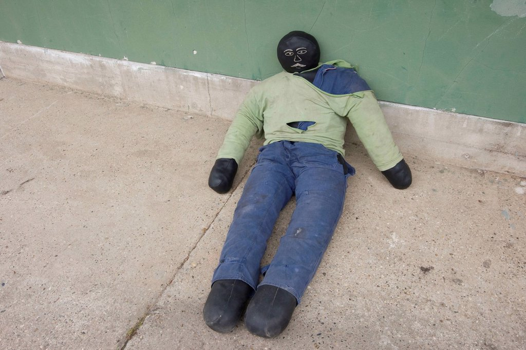 Rescue manikin lying at a wall, during a fire service drill : Stock Photo