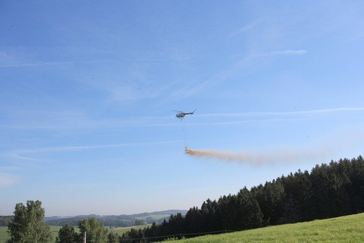 Stock Photo: 1848R-520597 Helicopter in flight, liming the forest, Ommerborn, Bergisches Land region, North Rhine_Westphalia, Germany, Europe