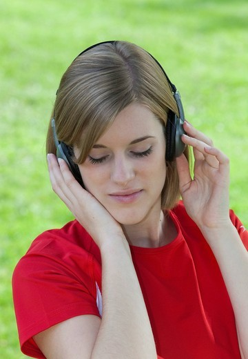 Stock Photo: 1848R-522447 Young woman wearing headphones