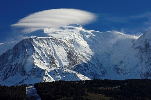 Stock Photo: 1848R-522978 A cloud crown hovering above the snow_covered Mont Blanc massif, peak Aiguille du Goûter in front, Chamonix, Haute_Savoie, France, Europe