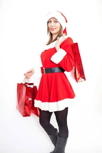 Woman in Christmas costume with gifts : Stock Photo