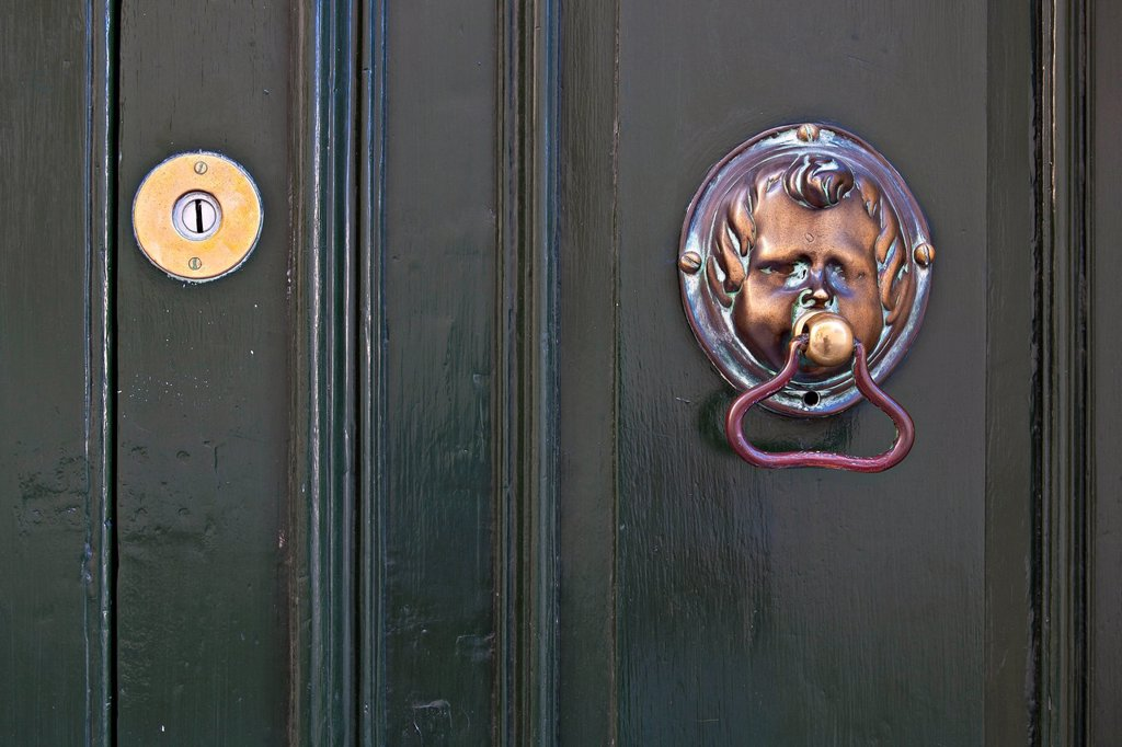 Stock Photo: 1848R-632588 Door knocker shaped like a face on front door, Valletta, Malta, Europe
