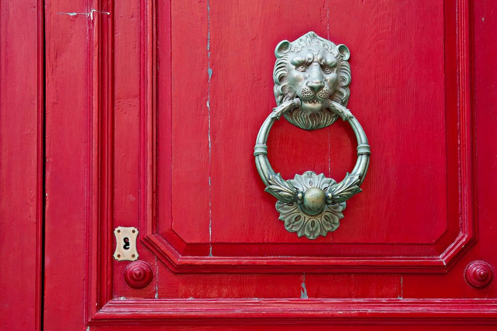 Stock Photo: 1848R-632590 Door knocker shaped like a lion head on front door, Valletta, Malta, Europe