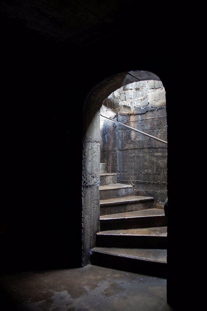 Stairs leading to a dark cellar or basement : Stock Photo