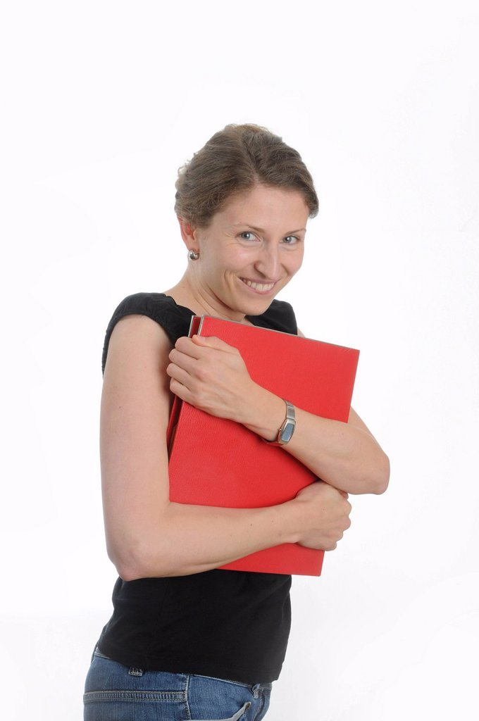 Young woman holding a red folder : Stock Photo