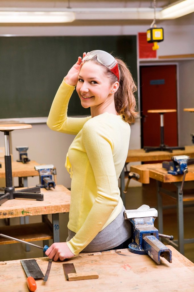 Stock Photo: 1848R-633429 Teenage schoolgirl in the classroom
