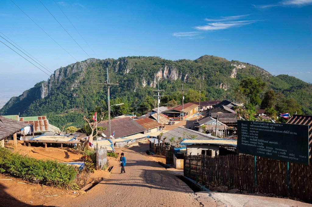 Houses roofed with corrugated iron, road, village of the Akha hill tribe, Santikhiri or Mae Salong area, Chiang Rai province, northern Thailand, Thailand, Asia : Stock Photo