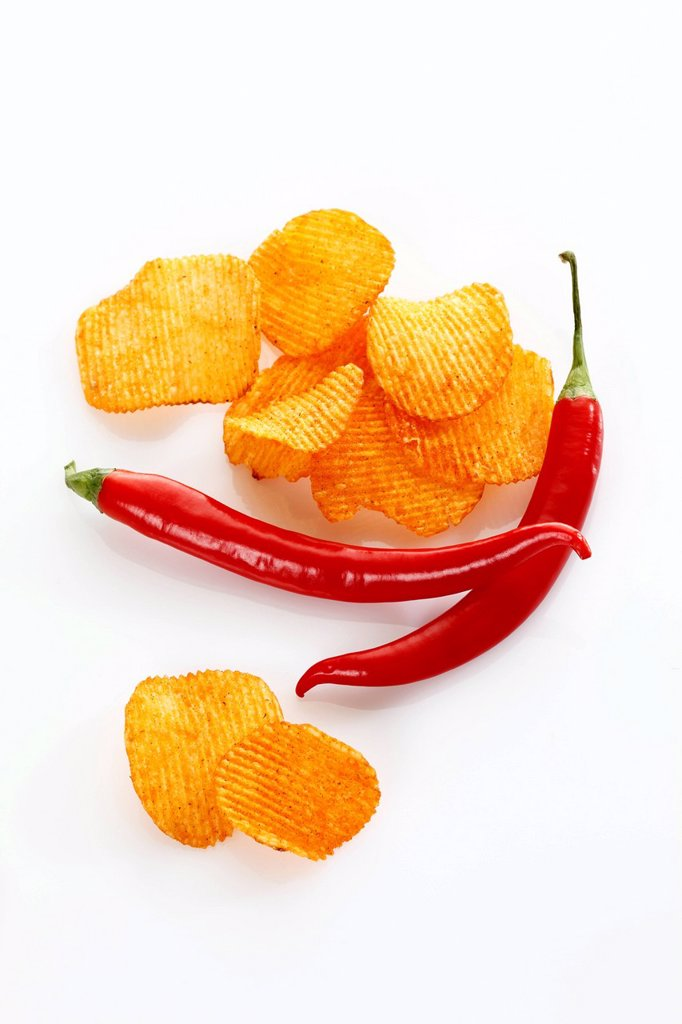 Paprika potato chips with chili peppers : Stock Photo