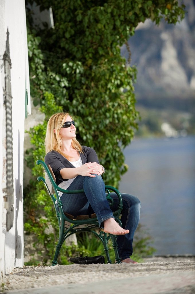 Stock Photo: 1848R-635372 Young woman sitting relaxed in the sunshine, Traunkirchen, Upper Austria, Austria, Europe