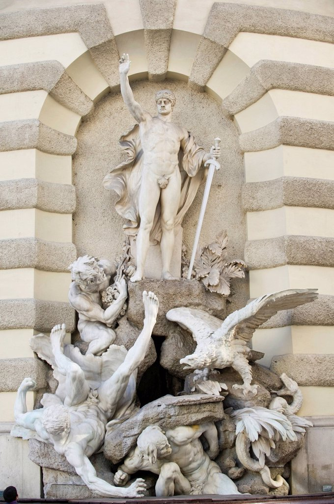 The power on land, 1897, fountain with statues on St. Michael´s Wing, Michaelerplatz, Hofburg Imperial Palace, Vienna, Austria, Europe : Stock Photo