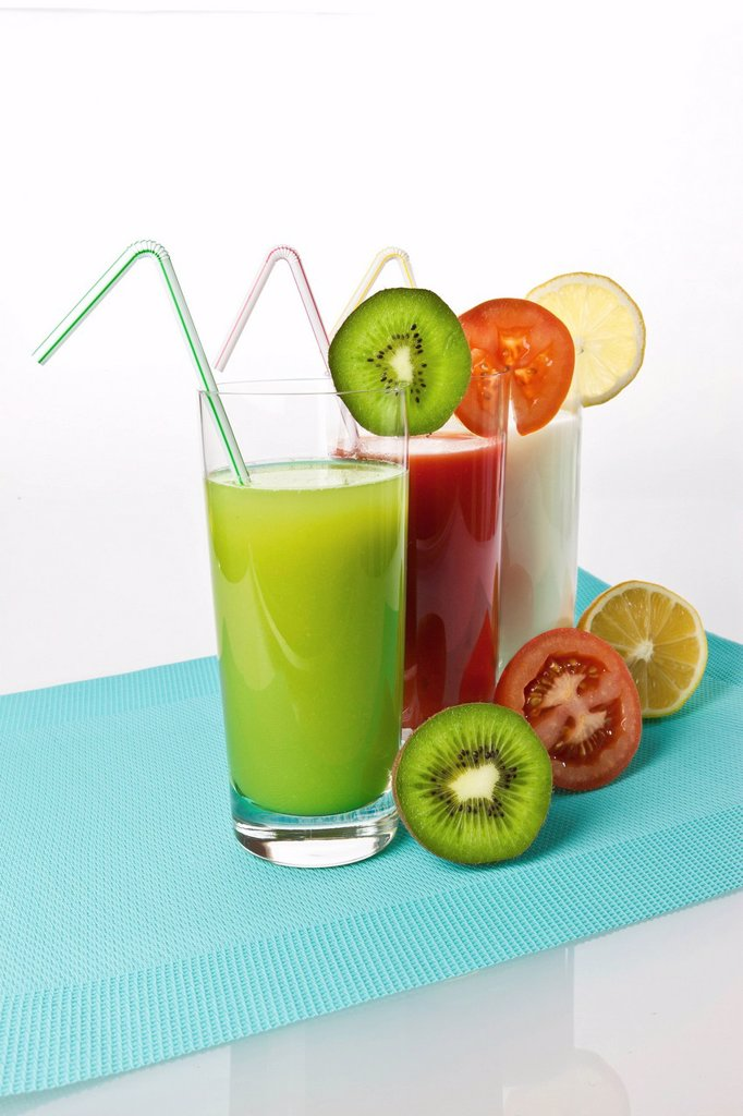 Stock Photo: 1848R-635545 Kiwi and lemon yogurt drinks and tomato juice in glasses with fruit