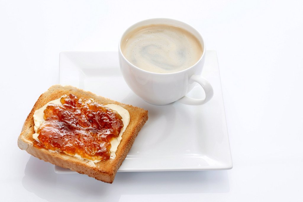 Stock Photo: 1848R-636060 Porcelain plate with a cup of coffee and toast with apricot jam