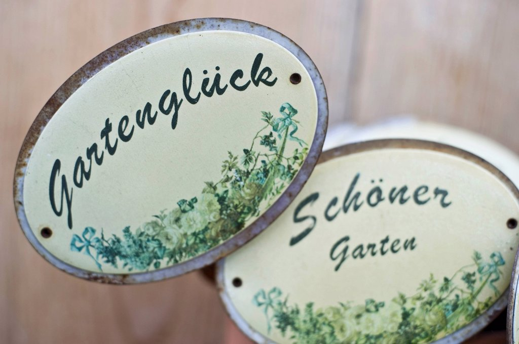 Old enamel signs for the garden : Stock Photo