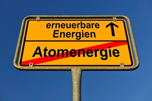 Symbolic image in the form of a town sign, in German, exit from atomic energy, entrance into renewable energy sources : Stock Photo