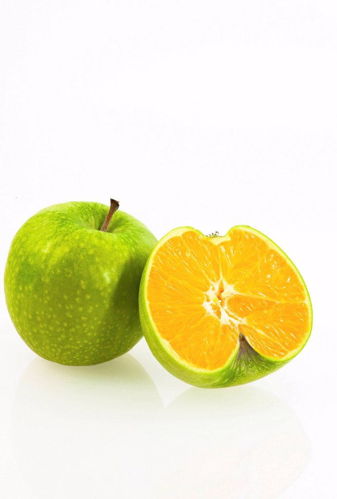 Cross between an apple and an orange, symbolic image for genetically modified fruit : Stock Photo