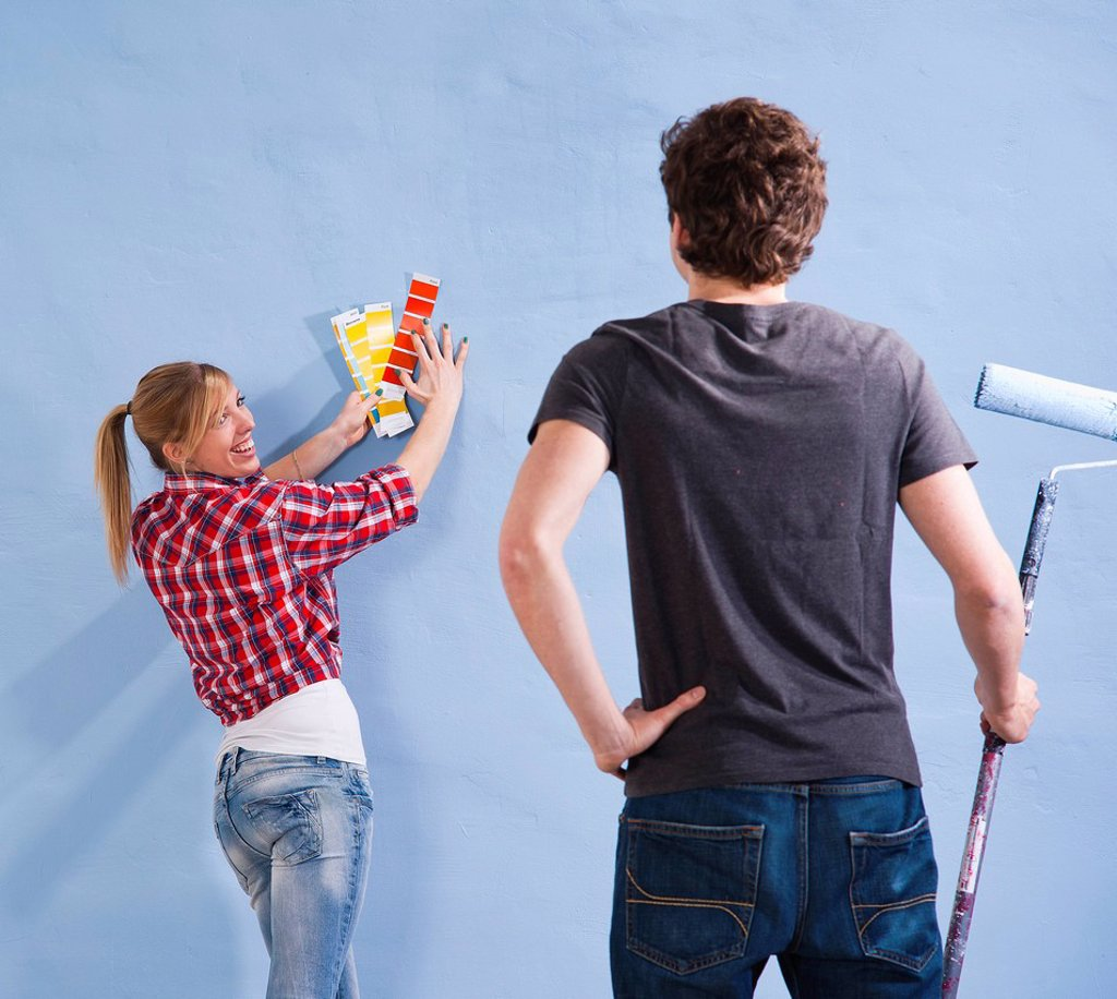 Stock Photo: 1848R-636785 Young couple using colour cards to select a wall paint colour